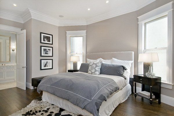 Dormitorio blanco detalle con colcha gris